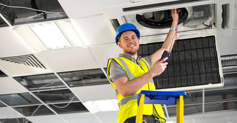 HVAC technician working on hvac unit